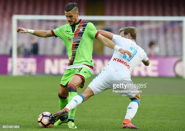 Napolis player Ivan Strinic vies with FC Crotone player Diego Falcinelli during the Serie A match between SSC Napoli and FC Crotone at Stadio San...