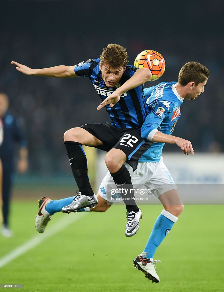 Napoli's player Jorginho vies with FC Internazionale Milano player Adem Ljajic during the Serie A match between SSC Napoli and FC Internazionale Milano at Stadio San Paolo on November 30, 2015 in Naples, Italy.