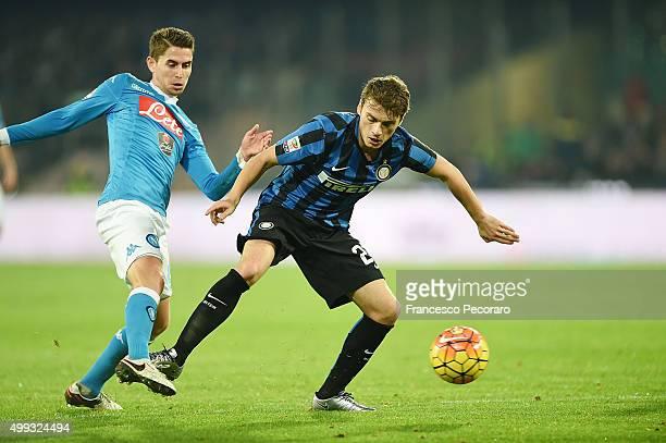 Napoli's player Jorginho vies with FC Internazionale Milano player Adem Ljajic during the Serie A match between SSC Napoli and FC Internazionale...