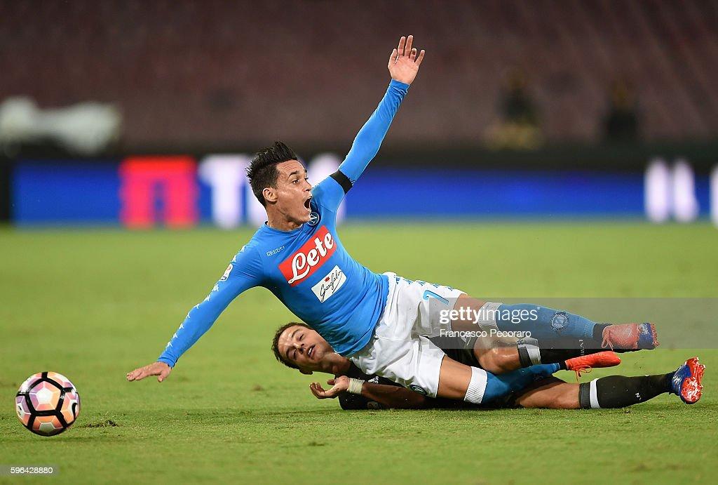 Napoli's player Jose Maria Callejon vies with AC Milan player Giacomo Bonaventura during the Serie A match between SSC Napoli and AC Milan at Stadio...