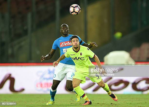 Napolis player Kalidou Koulibaly vies with Bologna FC player Simone Verdi during the Serie A match between SSC Napoli and Bologna FC at Stadio San...