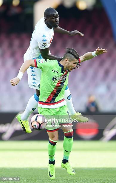 Napolis player Kalidou Koulibaly vies with FC Crotone player Diego Falcinelli during the Serie A match between SSC Napoli and FC Crotone at Stadio...