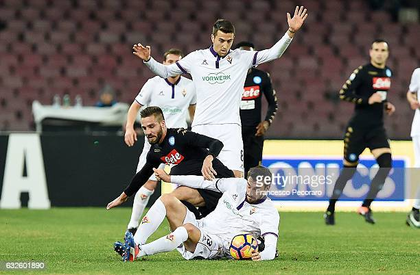 Napolis player Leonardo Pavoletti vies with ACF Fiorentina player Davide Astori during the TIM Cup match between SSC Napoli and ACF Fiorentina at...