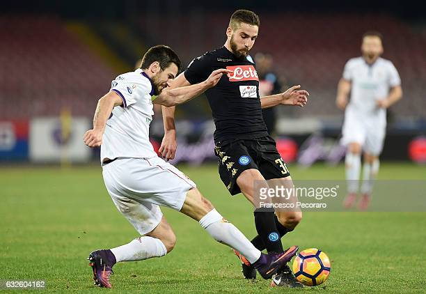 Napolis player Leonardo Pavoletti vies with ACF Fiorentina player Nenad Tomovic during the TIM Cup match between SSC Napoli and ACF Fiorentina at...