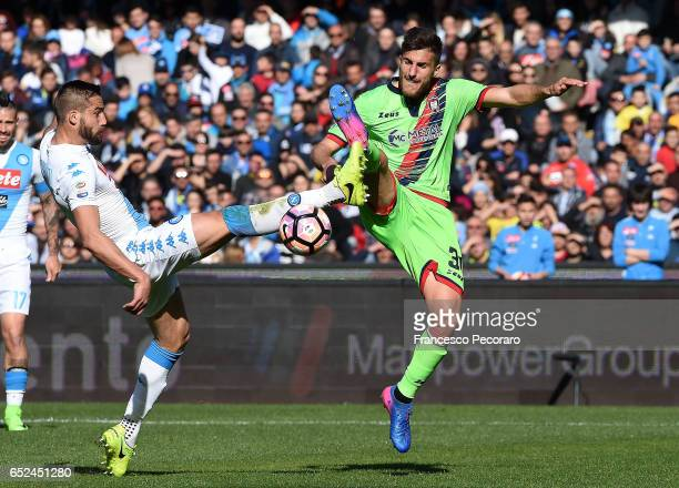 Napolis player Leonardo Pavoletti vies with FC Crotone player Mario Sampirisi during the Serie A match between SSC Napoli and FC Crotone at Stadio...