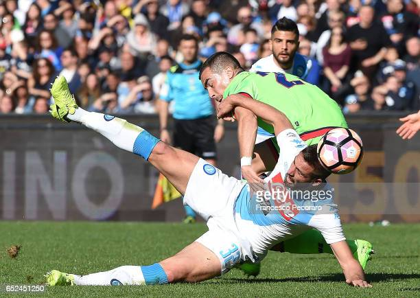 Napolis player Leonardo Pavoletti vies with FC Crotone player Noe Dussenne during the Serie A match between SSC Napoli and FC Crotone at Stadio San...