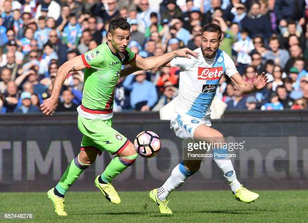 Napolis player Leonardo Pavoletti vies with FC Crotone player Gianmarco Ferrari during the Serie A match between SSC Napoli and FC Crotone at Stadio...