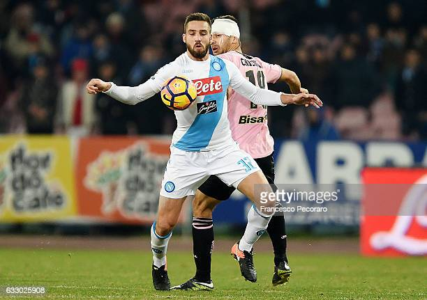 Napolis player Leonardo Pavoletti vies with US Citta di Palermo player Ivaylo Chochev during the Serie A match between SSC Napoli and US Citta di...