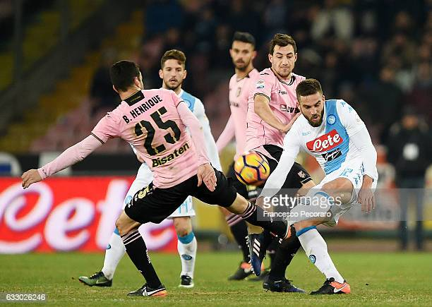 Napolis player Leonardo Pavoletti vies with US Citta di Palermo player Bruno Henrique during the Serie A match between SSC Napoli and US Citta di...