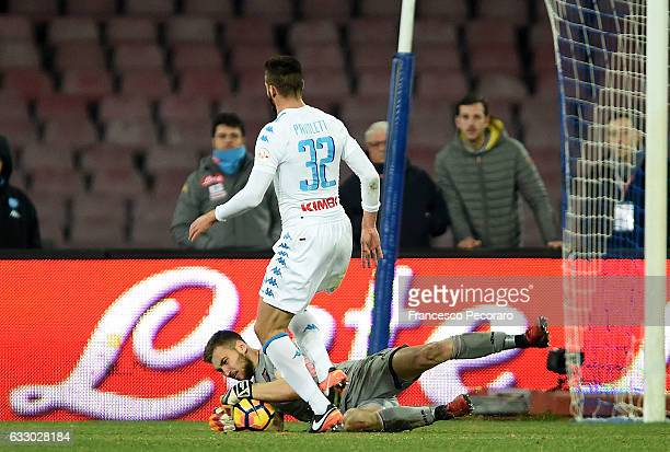 Napolis player Leonardo Pavoletti vies with US Citta di Palermo player Josip Posavec during the Serie A match between SSC Napoli and US Citta di...