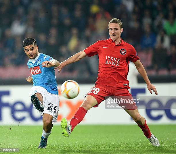 Napoli's player Lorenzo Insigne vies with FC Midtjylland playerAndrè Romèr during the UEFA Europa League Group D match between SSC Napoli and FC...
