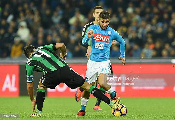 Napolis player Lorenzo Insigne vies with US Sassuolo player Francesco Magnanelli during the Serie A match between SSC Napoli and US Sassuolo November...