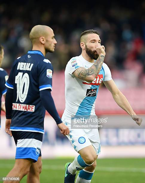 Napolis player Lorenzo Tonelli celebrates after scoring the 10 goal beside the disappointment of Ahmad Benali player of Pescara Calcio during the...