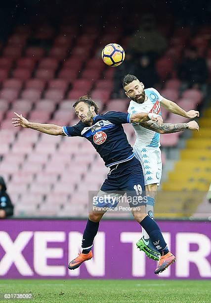Napolis player Lorenzo Tonelli vies with Pescara Calcio player Alberto Gilardino during the Serie A match between SSC Napoli and Pescara Calcio at...