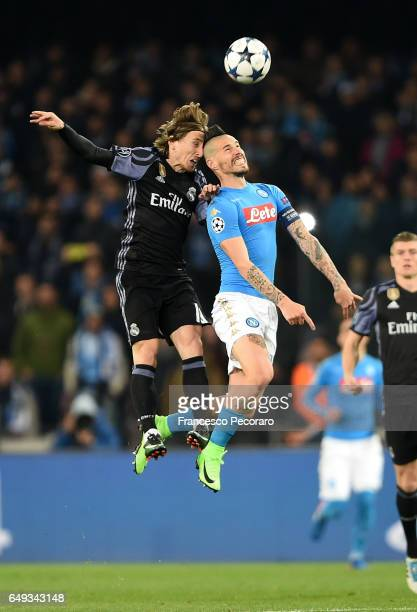 Napolis player Marek Hamsik vies with Real Madrid CF player Luca Modric during the UEFA Champions League Round of 16 second leg match between SSC...