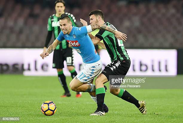 Napolis player Marek Hamsik vies with US Sassuolo player Luca Mazzitelli during the Serie A match between SSC Napoli and US Sassuolo November 28 2016...