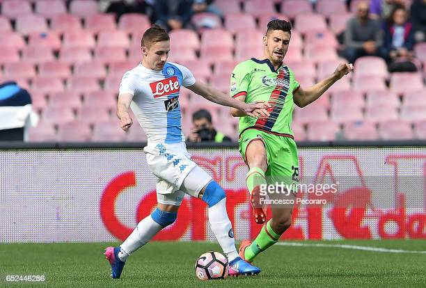 Napolis player Marko Rog vies with FC Crotone player Diego Falcinelli during the Serie A match between SSC Napoli and FC Crotone at Stadio San Paolo...