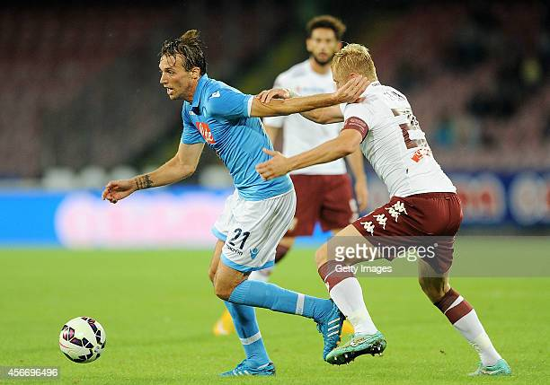 Napoli's player Miguel Michu vies with Torino's player Kamil Glik during an Italian Serie A football match SSC Napoli vs Torino at the San Paolo...