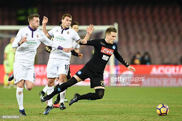 Napolis player Piotr Zielinski vies with ACF Fiorentina players Federico Bernardeschi and Sebastian Cristoforo during the TIM Cup match between SSC...
