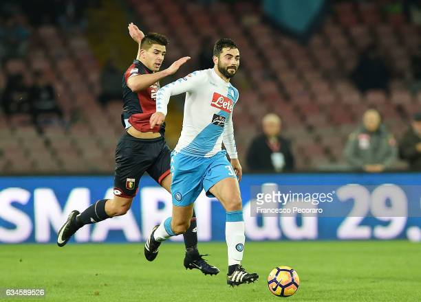 Napolis player Raul Albiol vies with Genoa CFC player Giovanni Simeone during the Serie A match between SSC Napoli and Genoa CFC at Stadio San Paolo...