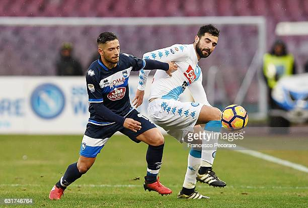 Napoli's player Raul Albiol vies with Pescara Calcio player Gianluca Caprari during the Serie A match between SSC Napoli and Pescara Calcio at Stadio...