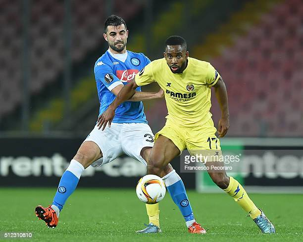 Napoli's player Raul Albiol vies with Villareal FC player Cedric Bakambu during the UEFA Europa League Round of 32 second leg match between SSC...