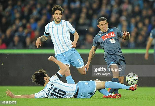 Napoli's player Walter Gargano vies with SS Lazio player Marco Parolo during the Tim cup match between SSC Napoli and SS Lazio at the San Paolo...