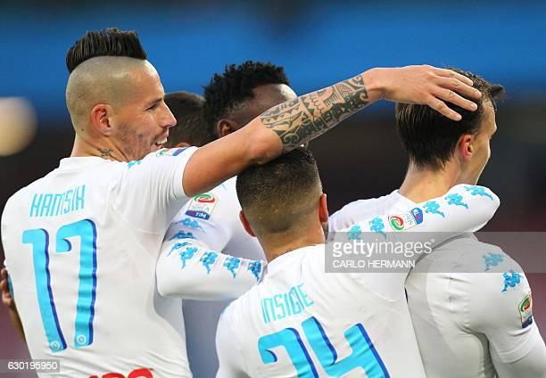 Napoli's players celebrate a goal during the Italian Serie A football match SSC Napoli vs Torino FC on December 18 2016 at the San Paolo Stadium in...