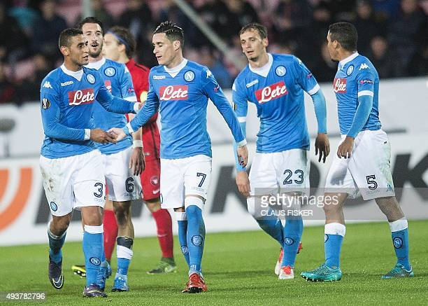 Napoli's players celebrate a goal during the UEFA Europa Leage football match FC Midtjylland v SSC Napoli in Herning on October 22 2015 AFP PHOTO /...