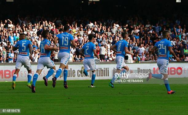Napoli's players celebrate after a goal by defender Kalidou Koulibaly during the Italian Serie A football match SSC Napoli vs AS Roma on October 15...