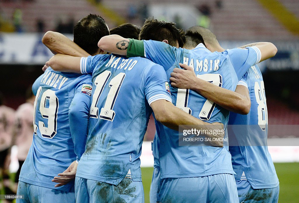 SSC Napoli's players celebrate after a goal during an Italian Serie A football match SSC Napoli vs US Palermo at San Paolo Stadium in Naples on January 13, 2013.