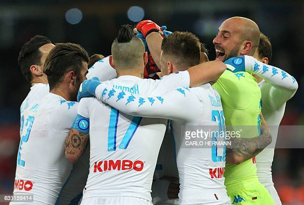 Napoli's players celebrate after scoring at the last minute during the Italian Serie A football match SSC Napoli vs UC Sampdoria on January 7 2017 at...