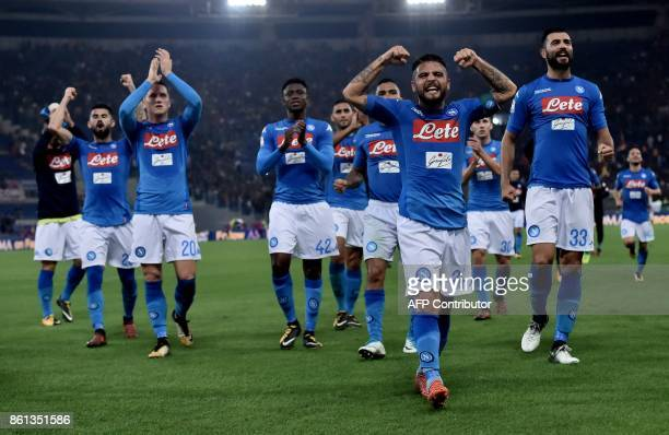 Napoli's players celebrate after winning the Italian Serie A football match Roma vs Napoli at the Olympic Stadium in Rome on October 14 2017 / AFP...
