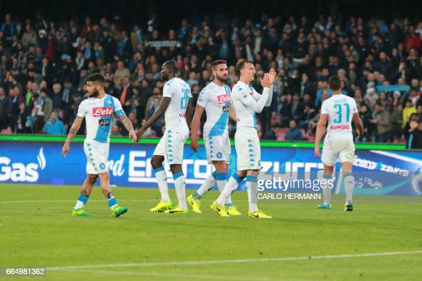 Napoli's players greet fans at the end of the Tim Cup semifinal second leg football match SSC Napoli vs Juventus FC on April 5 2017 at the San Paolo...
