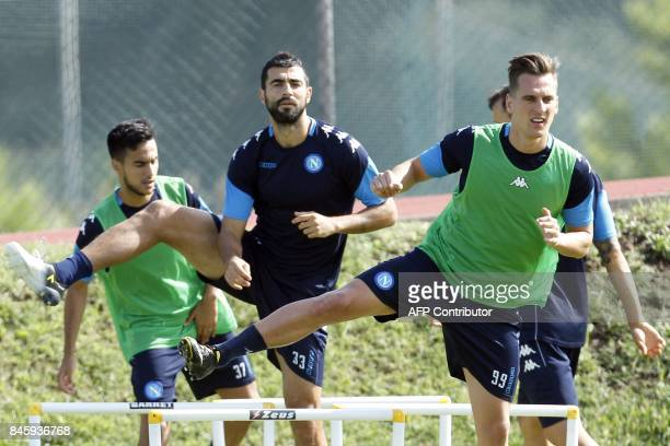 Napoli's Polish forward Arkadiusz Milik and Napoli's Spanish defender Raul Albiol take part in a training session on the eve of the UEFA Champions...