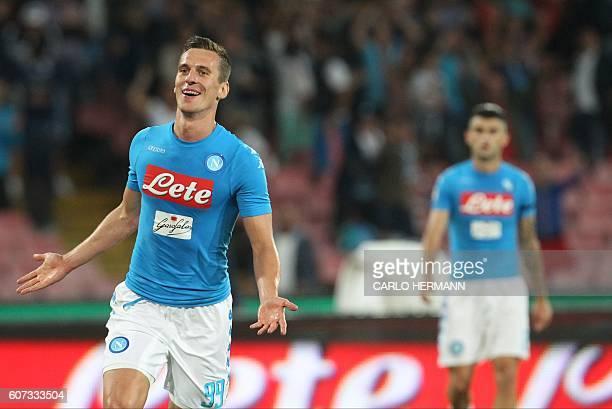 Napoli's Polish forward Arkadiusz Milik celebrates after scoring during the Italian Serie A football match SSC Napoli vs Bologna FC on September 17...