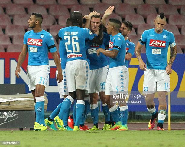 Napoli's Polish forward Arkadiusz Milik celebrates with teammates after scoring during the Italian Serie A football match SSC Napoli versus AC Milan...