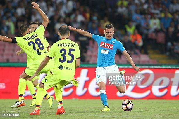 Napoli's Polish forward Arkadiusz Milik kicks the ball to score during the Italian Serie A football match SSC Napoli vs Bologna FC on September 17...