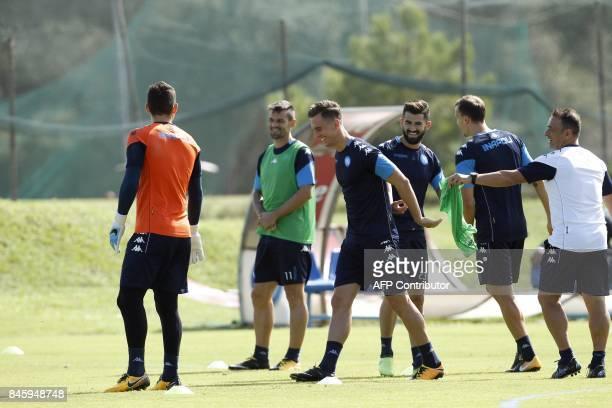 Napoli's Polish forward Arkadiusz Milik smiles during a training session on the eve of the UEFA Champions League Group F football match Shaktar...