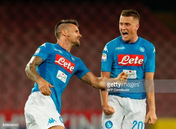 Napoli's Polish midfielder Piotr Zielinski celebrates after scoring with teammates during the Italian Serie A football match SSC Napoli vs Atalanta...