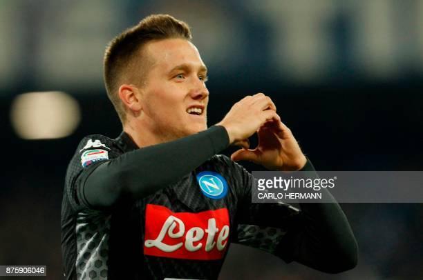 Napoli's Polish midfielder Piotr Zielinski celebrates after scoring during the Italian Serie A football match SSC Napoli vs AC Milan on November 18...