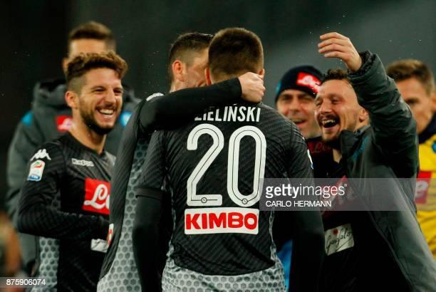 Napoli's Polish midfielder Piotr Zielinski celebrates with teammates after scoring during the Italian Serie A football match SSC Napoli vs AC Milan...