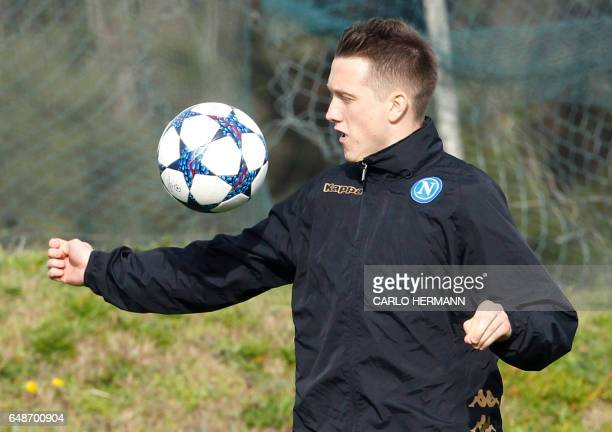 Napoli's Polish midfielder Piotr Zielinski controls the ball during a training session on the eve of the UEFA Champions League football match SSC...