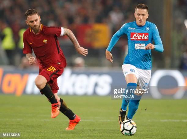 OLIMPICO ROME LAZIO ITALY Napoli's Polish midfielder Piotr Zielinski controls the ball near Roma's Italian midfielder Daniele De Rossi during the...