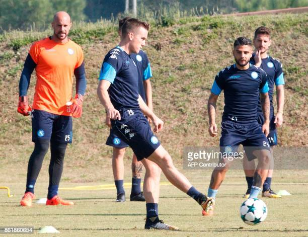 Napoli's Polish midfielder Piotr Zielinski controls the ball near Napoli's Spanish goalkeeper Pepe Reina and Napoli's Italian striker Lorenzo Insigne...