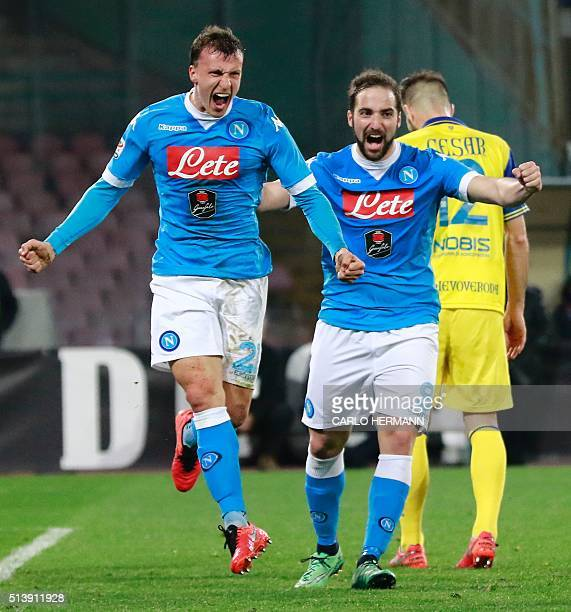 Napoli's Romanian defender Vlad Chiriches celebrates with teammates after scoring a goal during the Italian Serie A football match between SSC Napoli...
