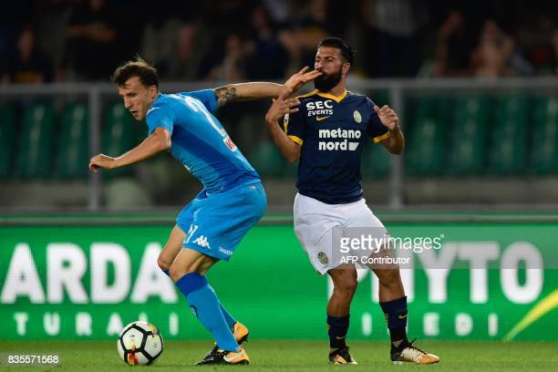 Napoli's Romanian defender Vlad Iulian Chiriches vies with Hellas Verona's Italian forward Daniele Verde during the Italian Serie A football match...