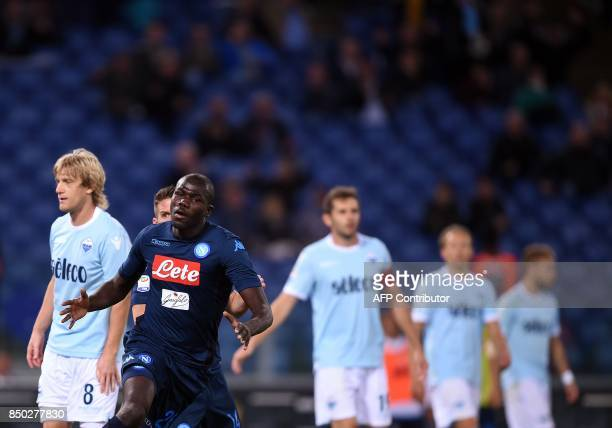 Napoli's Senegalese defender Kalidou Koulibaly celebrates after scoring during the italian Serie A football match Lazio vs Napoli at the Olympic...