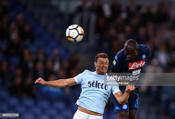 Napoli's Senegalese defender Kalidou Koulibaly heads the ball with Lazio's Romanian defender Stefan Radu during the italian Serie A football match...