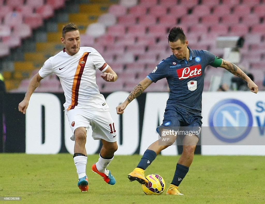 Napoli s Slovak forward Marek Hamsik R fights for the ball with
